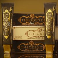 Theodent Chocolate flavored toothpaste displayed with their packaging