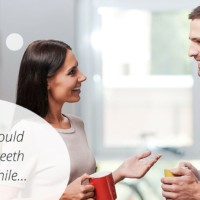 woman telling man to whiten his teeth